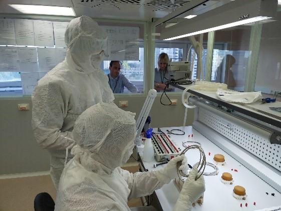 Véronique Dehant monitoring the instrument during sterile chamber testing